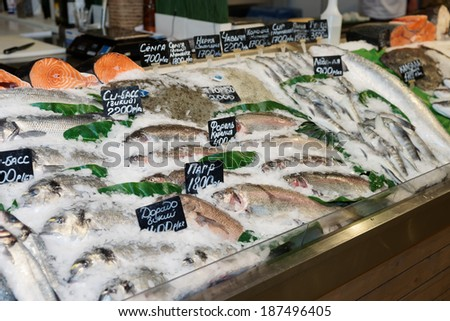 Choice of fish on a market display, labels contain no trademarks - stock photo