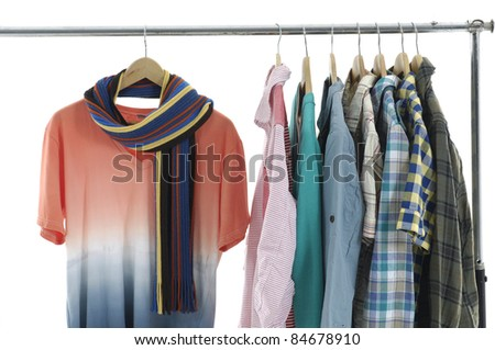 Choice of man clothes of different colors on hangers