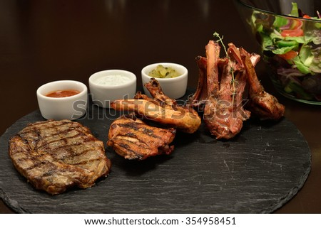 choice of meat, steak, poultry, lamb and a variety of sauces - stock photo