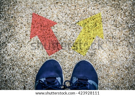 choices concept - feet on floor with direction arrows - stock photo