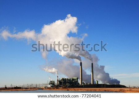 Cholla coal fired electric power plant in Arizona with white steam clouds and blue sky - stock photo
