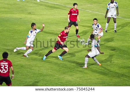 CHONBURI THAILAND - APRIL 9: M.Toth(C) in action at Thai Premier League (TPL) between MTutd (red) vs Siamnavy fc (white)  on April 9, 2011 at institute of physical education,Chonburi, Thailand - stock photo