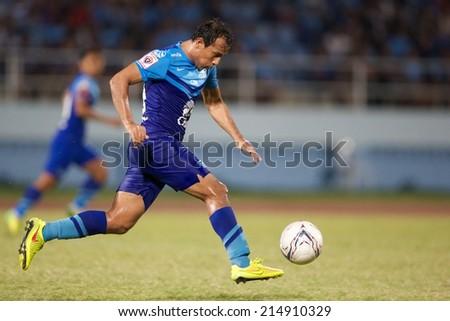 CHONBURI THAILAND-AUGUST20 :Adul Lahso of Chonburi F.C.run with the ball during The Thai Premier League, Chonburi F.C.and Muangthong utd. at Chonburi Stadium on Aug 20,2014 in Thailand. - stock photo