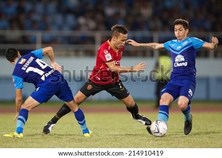 CHONBURI THAILAND-AUGUST20 :Datsakorn Thonglao (red) of Muangthong utd.in action during The Thai Premier League, Chonburi F.C.and Muangthong utd. at Chonburi Stadium on Aug 20,2014 in Thailand. - stock photo