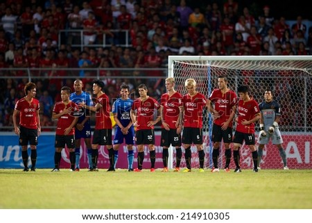 CHONBURI THAILAND-AUGUST20 :Players of Muangthong ute (RED) in action during The Thai Premier League, Chonburi F.C.and Muangthong utd. at Chonburi Stadium on Aug 20,2014 in Thailand. - stock photo