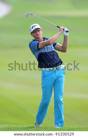 CHONBURI, THAILAND - DECEMBER 15: Adam GROOM of Australia plays a shot during day one of the Thailand Golf Championship at Amata Spring Country Club on December 15, 2011 in Chonburi, Thailand.