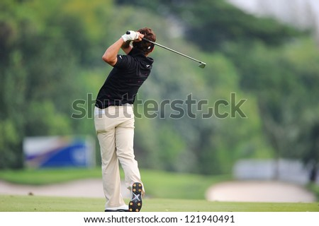 CHONBURI,THAILAND-DECEMBER 6: Daisuke Kataoka of Japan plays a shot during hole 3 day one of the Thailand Golf Championship at Amata Spring Country Club on December 6,2012 in Chonburi,Thailand. - stock photo