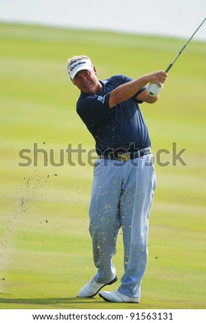 CHONBURI,THAILAND - DECEMBER 15:Darren CLARKE of NORTHERN IRELAND plays a shot during day one of the Thailand Golf Championship at Amata Spring Country Club on December 15, 2011 in Chonburi, Thailand.