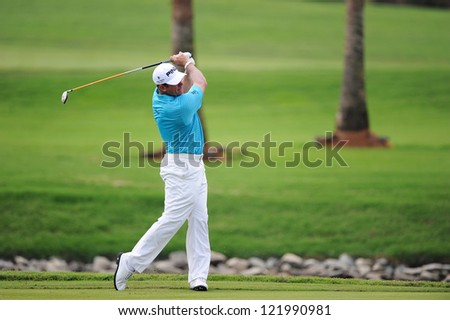 CHONBURI,THAILAND-DECEMBER 6:Lee Westwood of England hits a shot during hole 2 day one of the Thailand Golf Championship at Amata Spring Country Club on Dec 6,2012 in ,Thailand.