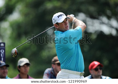 CHONBURI,THAILAND-DECEMBER 6:Lee Westwood of England watches the ball after hits a shot during hole 2 day one of the Thailand Golf Championship at Amata Spring Country Club on Dec 6,2012 in ,Thailand. - stock photo