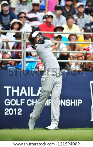 CHONBURI, THAILAND - DECEMBER 8 : Ryo Ishikawa in action during The Golf Championship Thailand Round 3 at Ammata Spring Country Club on December 8, 2012 in Chonburi, Thailand. - stock photo