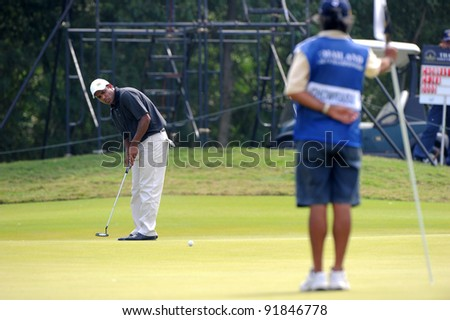 CHONBURI,THAILAND - DECEMBER 15:S.S.P CHOWRASIA  of 	 Indiaplays a shot during day one of the Thailand Golf Championship at Amata Spring Country Club on December 15, 2011 in Chonburi, Thailand.