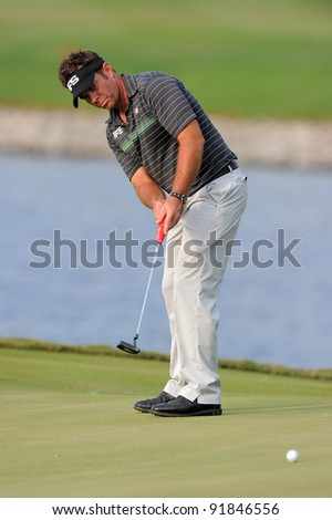 CHONBURI,THAILAND - DECEMBER 15:Scott BARR  of Australia plays a shot during day one of the Thailand Golf Championship at Amata Spring Country Club on December 15, 2011 in Chonburi, Thailand.