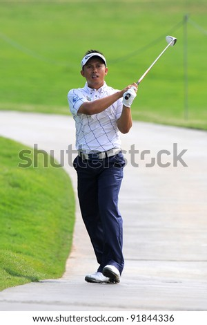 CHONBURI,THAILAND - DECEMBER 15: Sukree OTHMAN of 	Malaysia plays a shot during day one of the Thailand Golf Championship at Amata Spring Country Club on December 15, 2011 in Chonburi, Thailand.