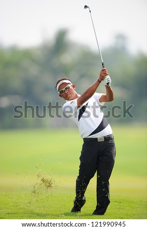 CHONBURI,THAILAND-DECEMBER 6:Thongchai Jaidee of Thailand hits a shot during hole 2 day one of the Thailand Golf Championship at Amata Spring Country Club on Dec 6,2012 in Chonburi,Thailand.