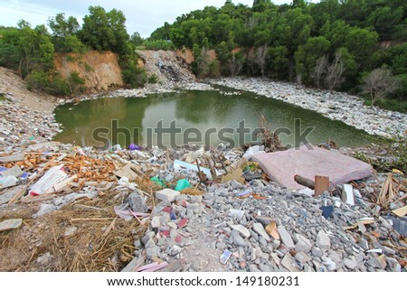 CHONBURI, THAILAND - JULY 14 : A mountain of dirty trash surrounding the lake in Chonburi Province on the 14th of July 2013.