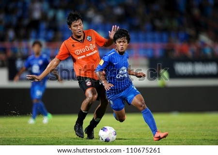 CHONBURI,THAILAND-14 JULY:Nurul Sriyankem (blue) of Chonburi fc.for the ball during Thai Premier League between Chonburi fc.and Samut Songkhram fc.at Chonburi Stadium on July 14,2012 in Thailand