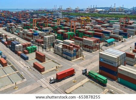 Chonburi, THAILAND - JULY 8, 2015: Thousands of steel containers waiting to be dispatch and shipped around the world from the biggest and busiest seaport in Thailand.