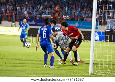 CHONBURI THAILAND- JUN 4 : P.Buntao (R) in action during Thai Premier League (TPL) between Chonburi Fc (Blue) vs Muang Thong utd (Red) on Jun 4, 2011 at Chonburi Stadium,Chonburi, Thailand