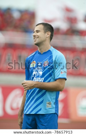 CHONBURI THAILAND- JUN 4 : V.Rivic in action during Thai Premier League (TPL) between  Chonburi Fc (Blue) vs Muang Thong utd (Red) on Jun 4, 2011 at   Chonburi Stadium,Chonburi, Thailand