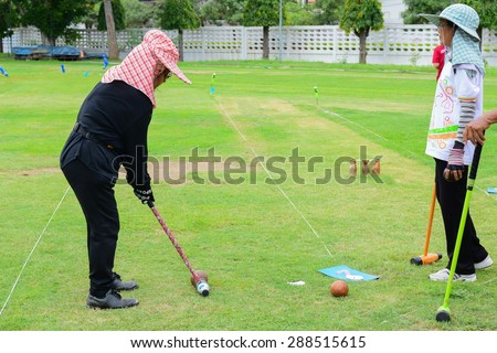 CHONBURI THAILAND 7 JUNE : unidentified elder woodball player playing ball game like golf .it easy to play for elder and all people at Satthip Chonburi Thailand on 7 June 2015.