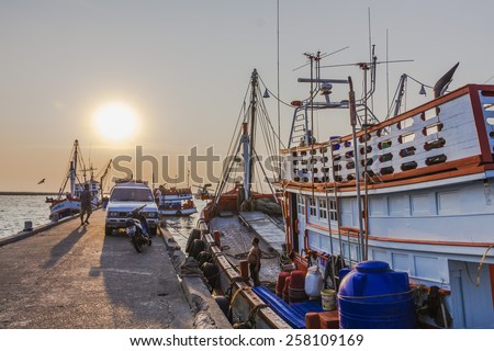 CHONBURI, THAILAND - 4 MARCH 2015 - At Anglia jetty in Chonburi province, fishermen are preparing their fishing boat for tonight trip.