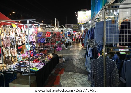 Chonburi, THAILAND - March 17, 2015:  Tourists stroll at the night market on MARCH 17, 2015 in Chonburi, Thailand. The famous night market in Chonburi, - stock photo