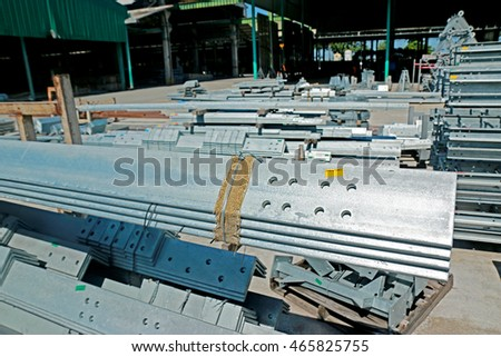 CHONBURI-THAILAND-NOVEMBER 24 : Hot-dip galvanized steel member for steel towers bunch on the rack in warehouse before shipment on December 24, 2015 Chonburi Province, Thailand