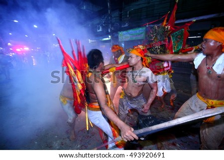CHONBURI, THAILAND-2016, October 2 : At night,The parade possessed by his god, They walking on fire cracks in Vegetarian Festival also known as Nine Emperor Gods Festival. Stop action and motion blur.