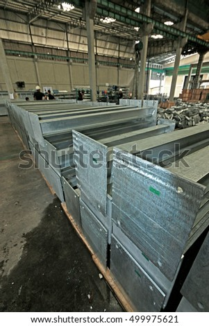 CHONBURI-THAILAND-OCTOBER 5 :  Hot-dip galvanized steel structure for transmission line tower bunch on the rack in warehouse before shipment, October 5, 2015 Chonburi Province, Thailand