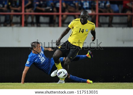 CHONBURI,THAILAND-OCTOBER 23	Ivan Bukenya (yellow) of Arbil S.C.(IRQ) in action during the AFC CUP  between Chonburi F.C.and Arbil S.C.(IRQ) at Chonburi Stadium on Oct 23,2012 in Thailand