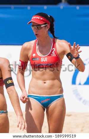 CHONBURI, THAILAND-OCTOBER 25: Joana Heidrich of Switzerland discusses game plan with partner during Day 2 of Bangsaen Thailand Open on October 25, 2012 at Bangsaen Beach in Chonburi, Thailand - stock photo
