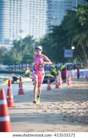 CHONBURI, THAILAND-OCTOBER 17, 2015: Unidentified triathlon competitor in Pattaya Triathlon Tour Series 2015 on Pattaya beach, Chonburi Province in Eastern of Thailand. - stock photo