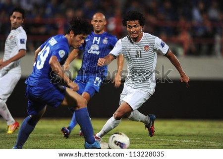 CHONBURI,THAILAND-SEP18:Geilson De.Soares (white) of Al Shorta (SYR) for the ball during the AFC CUP between Chonburi fc.and Al Shorta (SYR) at Chonburi Stadium on Sep18,2012 in Thailand