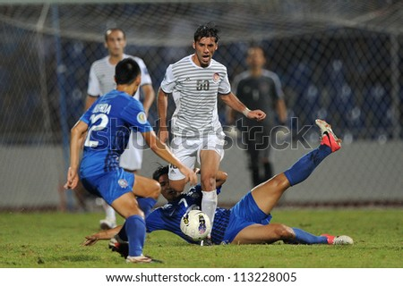 CHONBURI,THAILAND-SEP18:Oday Jafal  (white) of Al Shorta (SYR) for the ball during the AFC CUP between Chonburi fc.and Al Shorta (SYR) at Chonburi Stadium on Sep18,2012 in Thailand