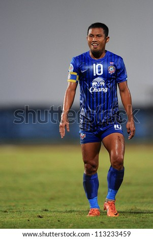 CHONBURI,THAILAND-SEPTEMBER18:Pipob On-Mo (blue)of Chonburi fc in action during the AFC CUP quarter finals between Chonburi fc.and Al Shorta(SYR) at Chonburi Stadium on Sep18,2012 in Thailand - stock photo