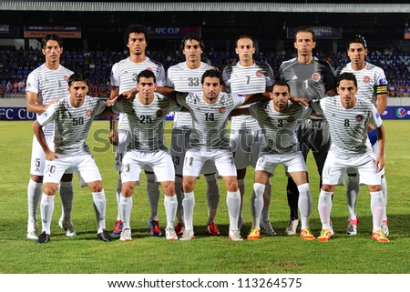 CHONBURI,THAILAND-SEPTEMBER18:Players  of Al Shorta(SYR) post for a photo during the AFC CUP quarter finals between Chonburi fc.and Al Shorta(SYR)at Chonburi Stadium on Sep18,2012inThailand - stock photo