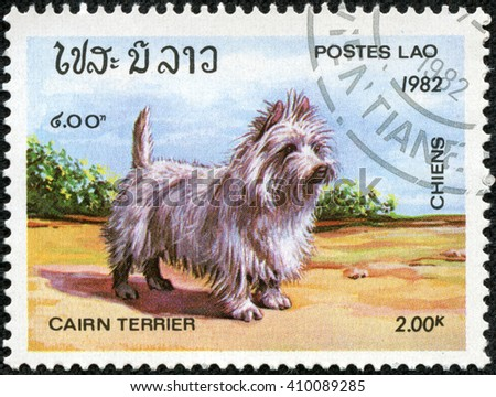 CHONGQING, CHINA - April 29, 2014: a stamp printed in Laos shows cairn terrier, Dog, circa 1982 - stock photo