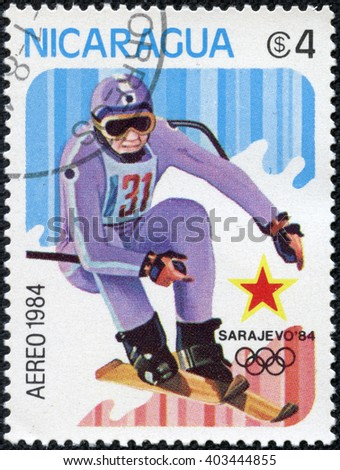 CHONGQING, CHINA - April 24, 2014:A stamp printed in Nicaragua shows Downhill skiing, circa 1984 - stock photo