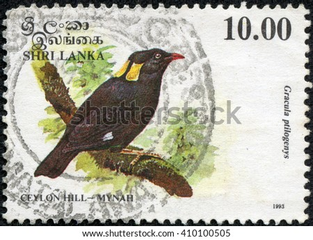 CHONGQING, CHINA - April 24, 2014:A stamp printed in Sri Lanka shows Sri Lanka myna (Gracula ptilogenys), circa 1993 - stock photo