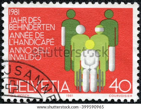 CHONGQING, CHINA - April 13, 2014:a stamp printed in Switzerland dedicated to International Year of Disabled, circa 1981 - stock photo