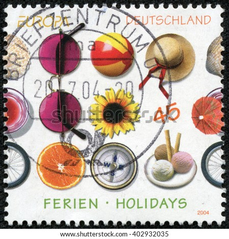 CHONGQING, CHINA - April 17, 2014:a stamp printed in the Germany shows Different Impressions from Holidays, circa 2004 - stock photo