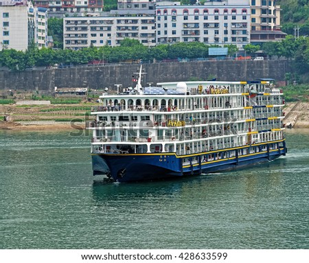 CHONGQING, CHINA â?? April 14, 2016: Chinese river cruiser on the Yangtze River. One out of every three Chinese people is living on Yangtze. - stock photo