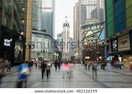 Chongqing,China - April 8, 2014: People walking in Business center of Chongqing, Chongqing is the largest direct-controlled municipality and comprises 19 districts, 15 counties and 4 counties.
