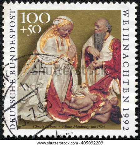 CHONGQING, CHINA - April 22, 2014:stamp printed in Germany, shows Carvings from Church of St. Anne, Annaberg-Buchholz, by Franz Maidburg:  The Nativity, circa 1992 - stock photo