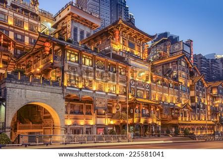 Chongqing, China at Hongyadong Hillside Buildings at twilight. - stock photo