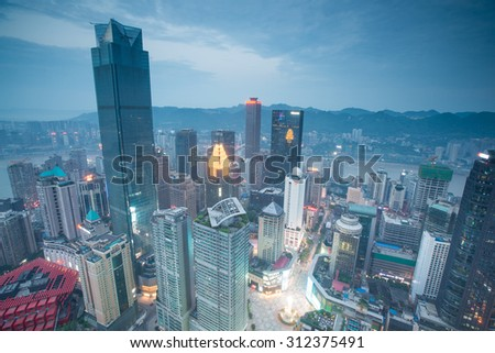 CHONGQING, CHINA - August 13, 2015: Aerial view of the downtown in Chongqing . Chongqing is the largest direct-controlled municipality and comprises 19 districts, 15 counties and 4 counties. - stock photo