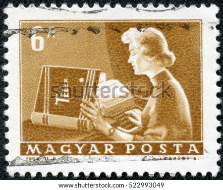 CHONGQING, CHINA - May 9, 2014:a stamp printed by Hungary shows Telex operator. Series Post and Reporting. Circa 1964.