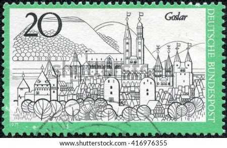 "CHONGQING, CHINA - May 9, 2014:A stamp printed in Germany from the ""Tourism"" issue shows Goslar, circa 1971. - stock photo"