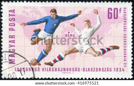 CHONGQING, CHINA - May 9, 2014:a stamp printed in Hungary celebrates Soccer world cup showing illustration of soccer players, circa 1966 - stock photo